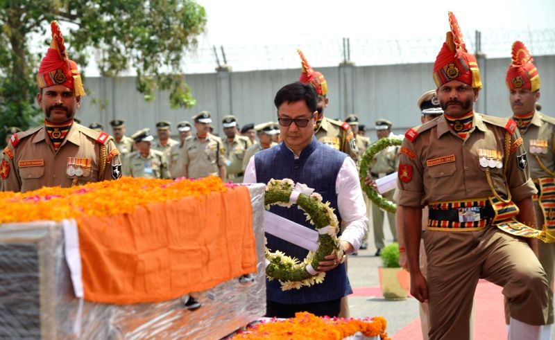New Delhi : Union MoS for Home Affairs Kiren Rijiju pays tributes to the martyred BSF head constable Prem Sagar in New Delhi on May 02, 2017.