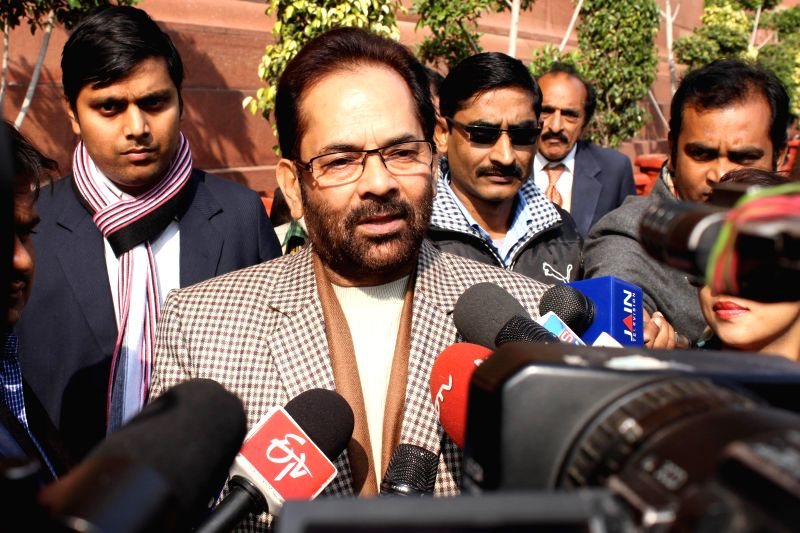 Union MoS for Minority Affairs and Parliamentary Affairs Mukhtar Abbas Naqvi talks to press at the Parliament premises in New Delhi, on Dec 16, 2014.