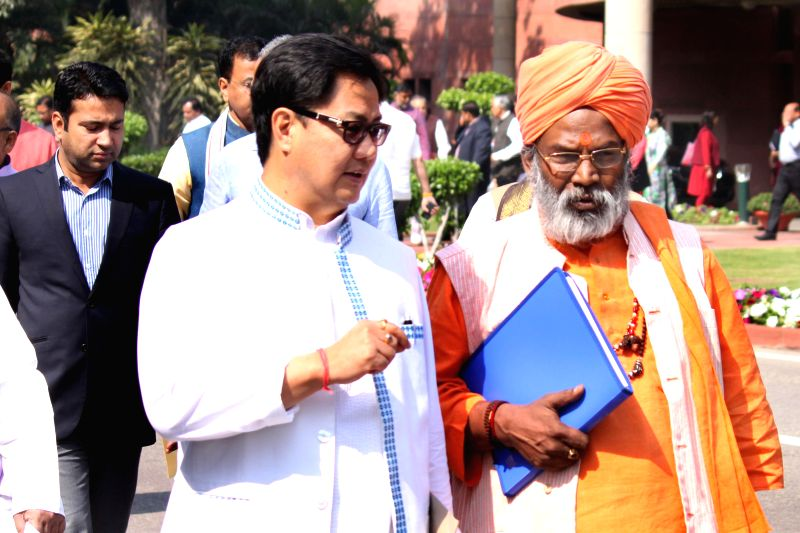 Union MoS Home Kiren Rijjiju and BJP MP Sakshi Maharaj at the Parliament in New Delhi, on March 17, 2015.