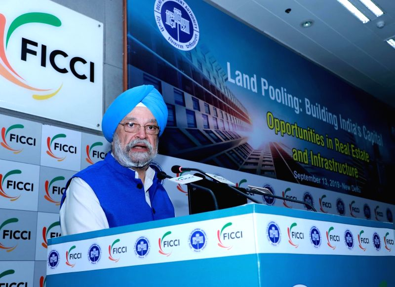 """New Delhi: Union MoS Housing and Urban Affairs, Civil Aviation (Independent Charge) and Commerce and Industry Hardeep Singh Puri addresses at the Conference on """"Land Pooling: Building India's Capital, Potential Investment Opportunities in Real Estate"""