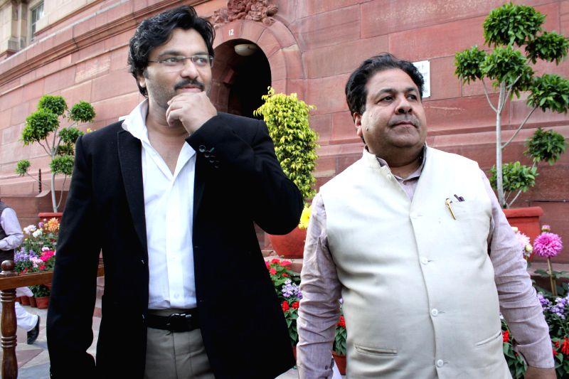 Union MoS Urban Development, Babul Supriyo and Congress leader Rajeev Shukla at the Parliament in New Delhi, on March 12, 2015.