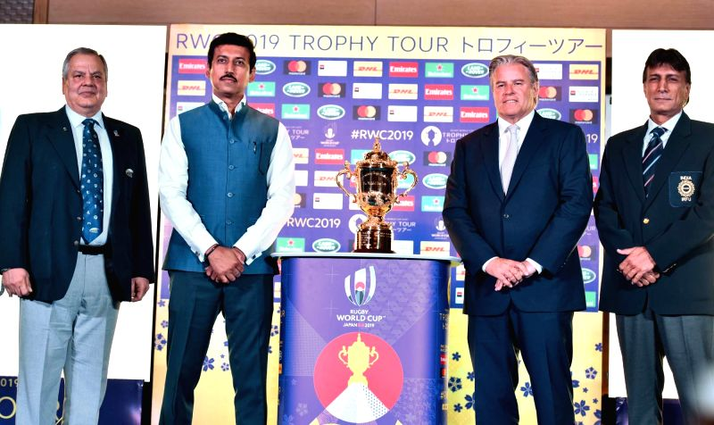 :New Delhi: Union MoS Youth Affairs and Sports Rajyavardhan Singh Rathore unveils the Rugby World Cup-2019 Trophy during a programme, in New Delhi, on  Aug 6, 2018 (Photo: IANS/PIB).