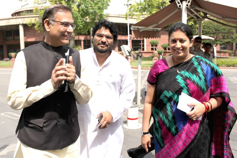 Union MoSs Jayant Sinha and Babul Supriyo with Union HRD Minister Smriti Irani  at the Parliament in New Delhi, on April 21, 2015. - Smriti Irani and Jayant Sinha