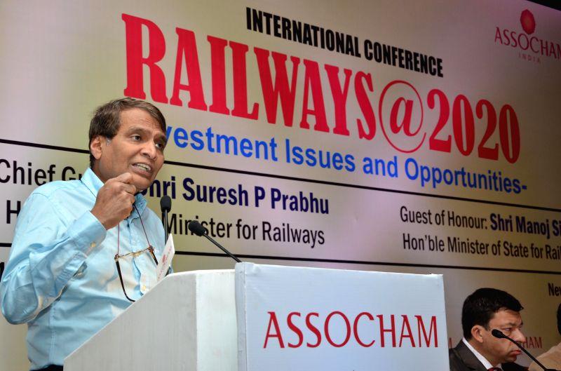 Union Railway Minister Suresh Prabhakar Prabhu addresses during a an international conference on `Railways@2020 - Investment Issues and Opportunities` in New Delhi on March 11, 2015. - Suresh Prabhakar Prabhu