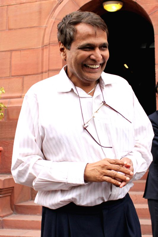 Union Railway Minister Suresh Prabhu at the Parliament on the second day of the budget session in New Delhi, on Feb 24, 2015. - Suresh Prabhu