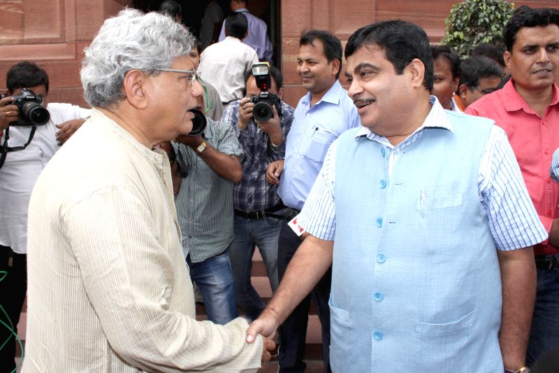 Union Road, Transport and Highways Minister Nitin Gadkari and CPI-M General Secretary Sitaram Yechury at Parliament house on April 21, 2015. - Nitin Gadkari and Sitaram Yechury