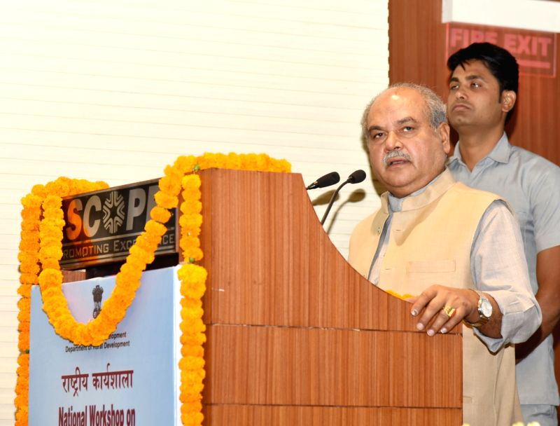 New Delhi: Union Rural Development Minister Narendra Singh Tomar addresses at the National Workshop on Experience Sharing under Shyama Prasad Mukherji Rurban Mission, in New Delhi on June 24, 2019. (Photo: IANS/PIB)