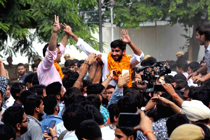 New Delhi University Students Union (DUSU) vice-president Kumal Sehrawat along with fellow members celebrate after NSUI bagged the posts of President and Vice President in the DUSU ...