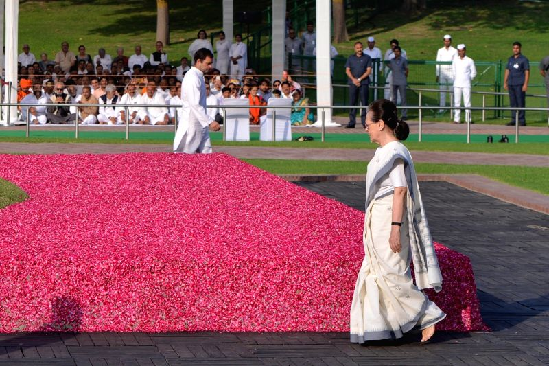 New Delhi: UPA Chairperson Sonia Gandhi and Congress president Rahul Gandhi pay tribute to Jawaharlal Nehru on his death anniversary at Shantivan, New Delhi on May 27, 2019. (Photo: IANS)