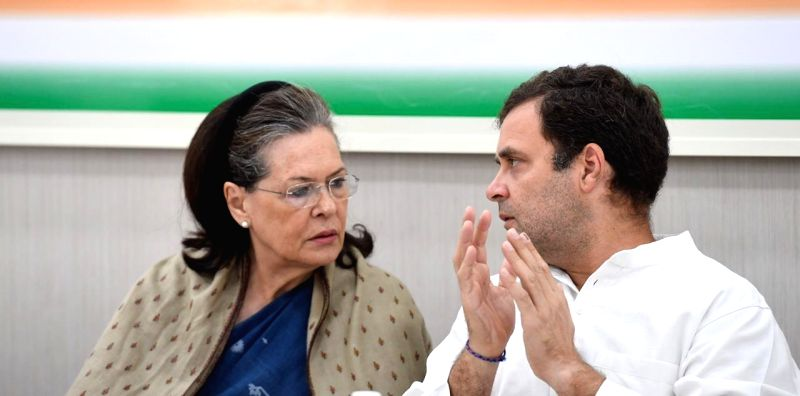 New Delhi: UPA Chairperson Sonia Gandhi in a conversation with her son and Congress President Rahul Gandhi during the Congress Working Committee (CWC) meeting at the party's headquarters in New Delhi, on May 25, 2019.