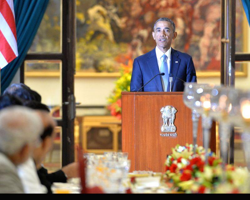 US President Barack Obama addresses at a banquet hosted by President Pranab Mukherjee in his honour at Rashtrapati Bhavan, in New Delhi on Jan 25, 2015. - Pranab Mukherjee