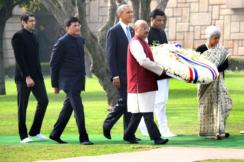 US President Barack Obama arrives to lay wreath at Raj Ghat - Mahatma Gandhi's memorial, in New Delhi, on Jan 25, 2015. Also seen Union Minister of State (Independent Charge) for Power, ...