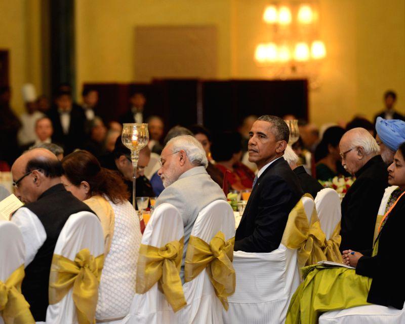 US President Barack Obama at a banquet hosted by President Pranab Mukherjee in his honour at Rashtrapati Bhavan, in New Delhi on January 25, 2015. Also seen Prime Minister Narendra Modi, .. - Narendra Modi, Pranab Mukherjee and Rajnath Singh