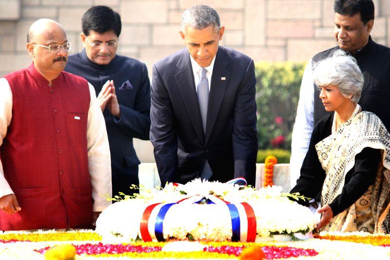 US President Barack Obama lays wreath at Raj Ghat - Mahatma Gandhi's memorial, in New Delhi, on Jan 25, 2015. Also seen Union Minister of State (Independent Charge) for Power, Coal and New