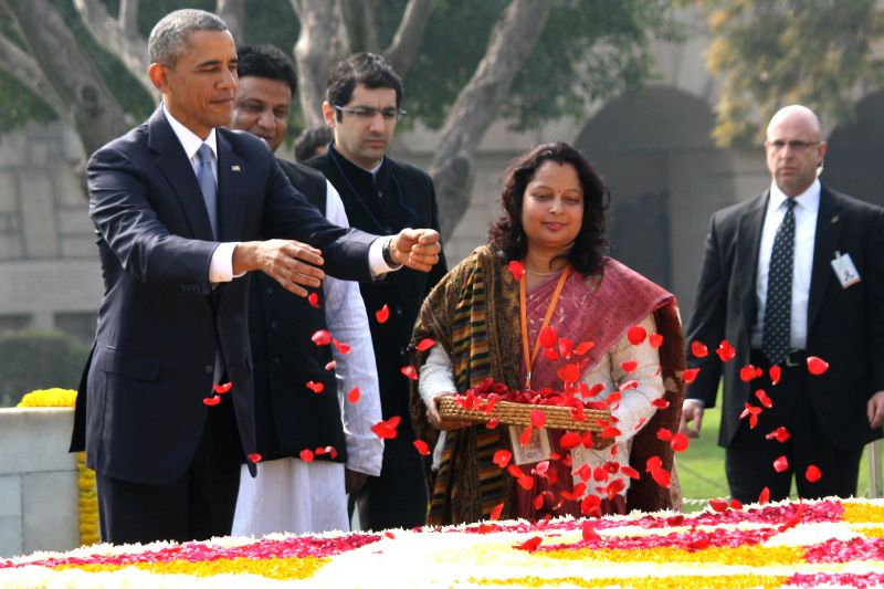 US President Barack Obama pays floral tribute to Mahatma Gandhi at  Raj Ghat -Gandhi's memorial, in New Delhi, on Jan 25, 2015. Also seen Union Minister of State (Independent Charge) for ..
