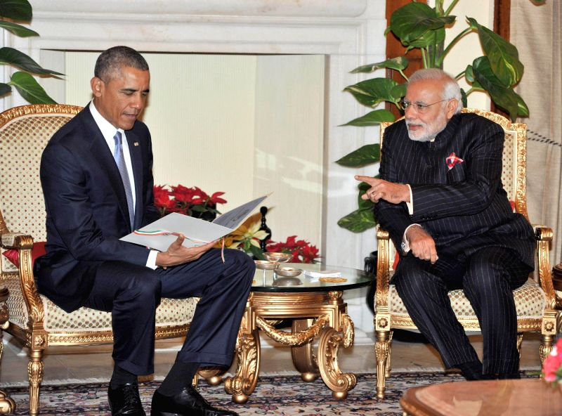 US President Barack Obama takes a look at a reproduction of telegram sent by USA to the Indian Constituent Assembly in 1946, which was presented to him by Prime Minister Narendra Modi in .. - Narendra Modi