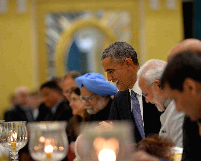 US President Barack Obama with Prime Minister Narendra Modi and former prime minister Manmohan Singh at a banquet hosted by President Pranab Mukherjee in his honour at Rashtrapati Bhavan, . - Narendra Modi, Manmohan Singh and Pranab Mukherjee