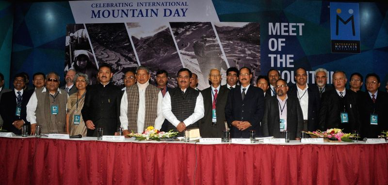 Uttarakhand Chief Minister Harish Rawat with the representatives of eleven mountainous states of India during a programme organised on the eve of International Mountain Day in New Delhi, .. - Harish Rawat