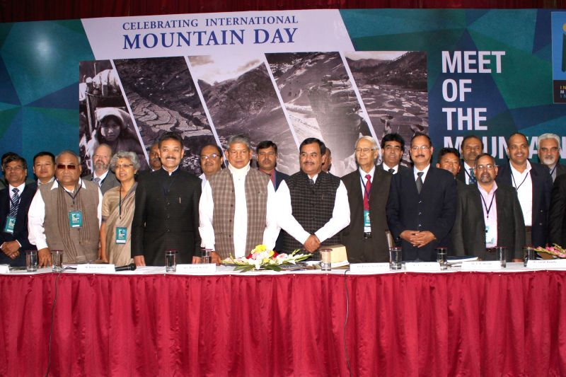 Uttarakhand Chief Minister Harish Rawat with the representatives of eleven mountainous states of India during `Meet of Mountain States`- a programme organised on the eve of International .. - Harish Rawat