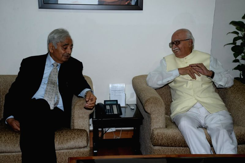 Veteran BJP leader LK Advani with PDP patron Mufti Mohammad Sayeed during a meeting in New Delhi on Feb. 27, 2015.