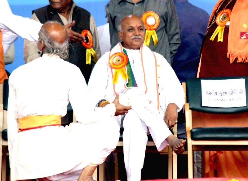 VHP leader Praveen Togadia and others during VHP's Virat Hindu Sammelan at the Jawaharlal Nehru Stadium in New Delhi, on March 1, 2015.