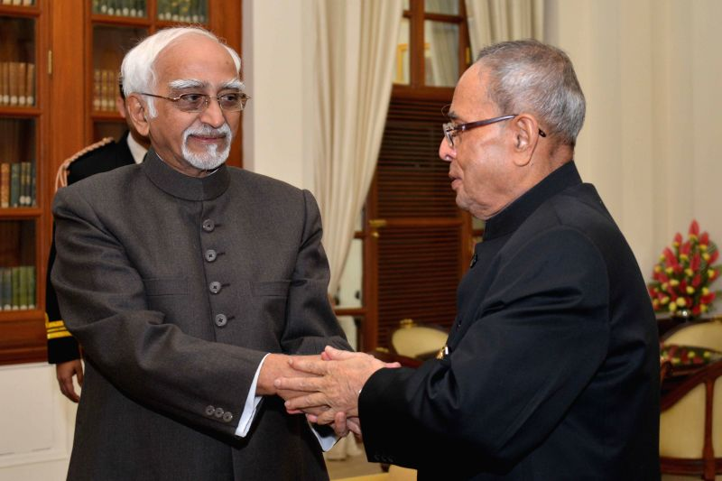 Vice-President Mohammad Hamid Ansari calls on President Pranab Mukherjee to wish him on new year at Rashtrapati Bhavan in New Delhi, on Jan 1, 2015. - Pranab Mukherjee
