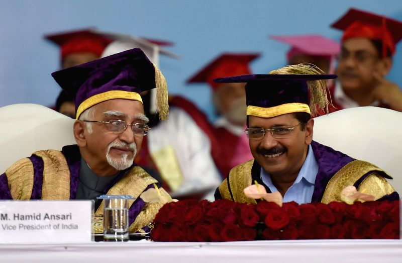 Vice-President Mohammad Hamid Ansari and Delhi Chief Minister Arvind Kejriwal during the 10th Convocation of Guru Gobind Singh Indraprastha University in New Delhi, on March 26, 2015. - Arvind Kejriwal