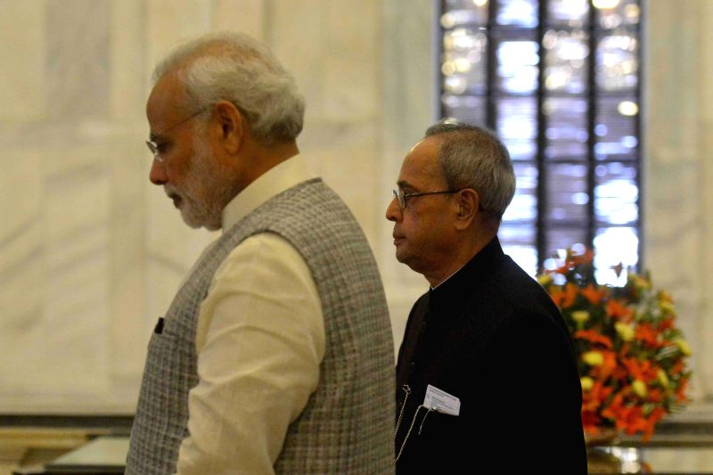 Vice President Mohd. Hamid Ansari, Prime Minister Narendra Modi, Union Home Minister Rajnath Singh and other dignitaries at a Civil Investiture Ceremony, at Rashtrapati Bhavan, in New ... - Narendra Modi and Rajnath Singh