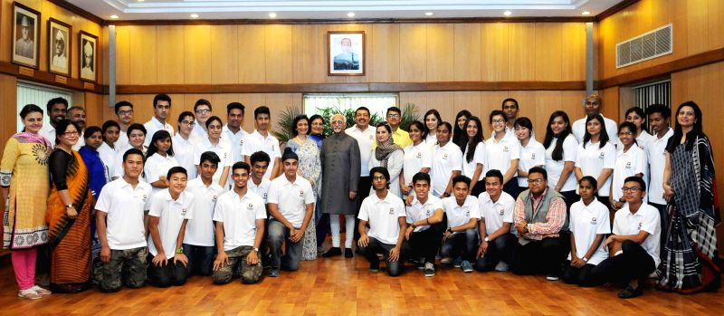 Vice President Mohd. Hamid Ansari with the students participating in project `Planet Harmony`, in New Delhi on June 8, 2015.