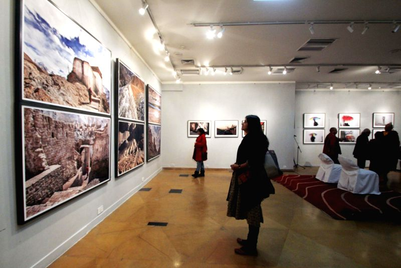 Visitors at Kishore Thukral's photography exhibition in New Delhi, on Jan 14, 2015.