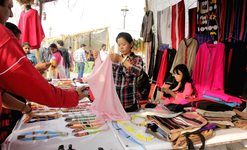 Visitors at the week-long National Tribal Festival, `Vanaj 2015` organised at the Central Park in New Delhi, on Feb 17, 2015.