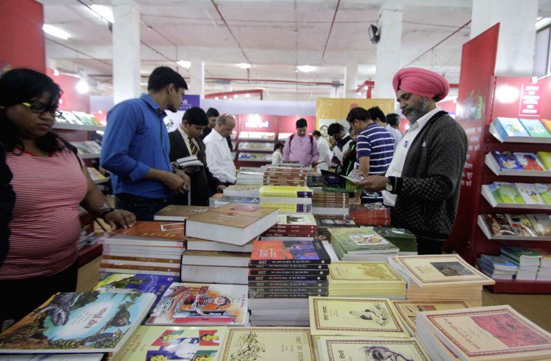 Visitors at the `World Book Fair` organised at Pragati Maidan, in New Delhi, on Feb 15, 2015.