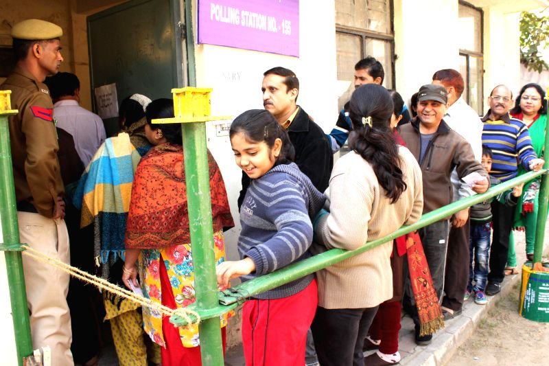 Voters at a polling station in New Delhi on Feb 07, 2015.