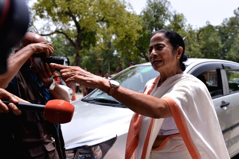 : New Delhi: West Bengal Chief Minister and TMC supremo Mamata Banerjee talks to the media at Parliament, in New Delhi on Aug 1, 2018. (Photo: IANS).