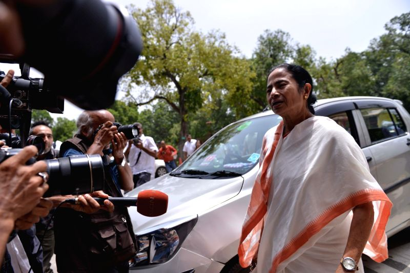 :New Delhi: West Bengal Chief Minister and TMC supremo Mamata Banerjee talks to the media at Parliament, in New Delhi on Aug 1, 2018. (Photo: IANS).