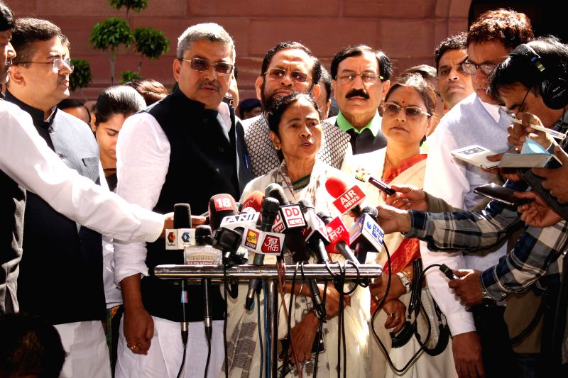West Bengal Chief Minister Mamata Banerjee addresses press after meeting Prime Minister Narendra Modi at the Parliament in New Delhi, on March 9, 2015. - Narendra Modi