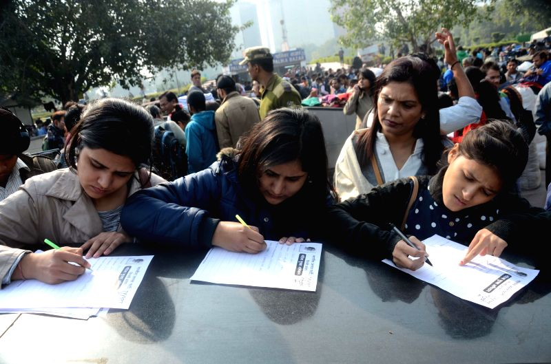 Women participate in BJP's women safety campaign in New Delhi on Dec 16, 2014.