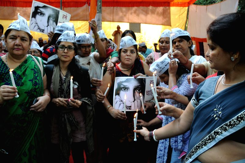 Women workers of Aam Aadmi Party (AAP) participate in a candlelight vigil to condemn crime against women at Jantar Mantar in New Delhi, on May 4, 2015.