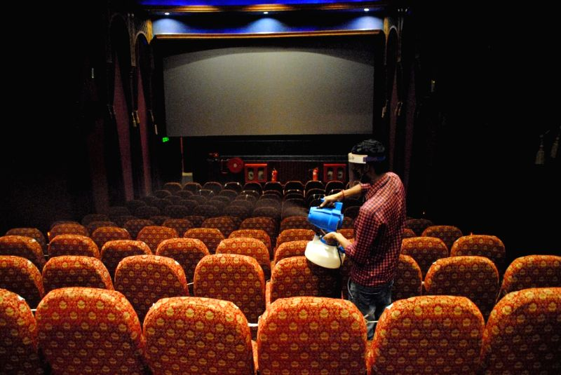 New Delhi: Workers sanitized cinema hall after the reopen from Monday for 50% by Delhi Government at Delight picture hall Daryaganj in New Delhi on Sunday July 25, 2021. (Photo: Qamar Sibtain/IANS)