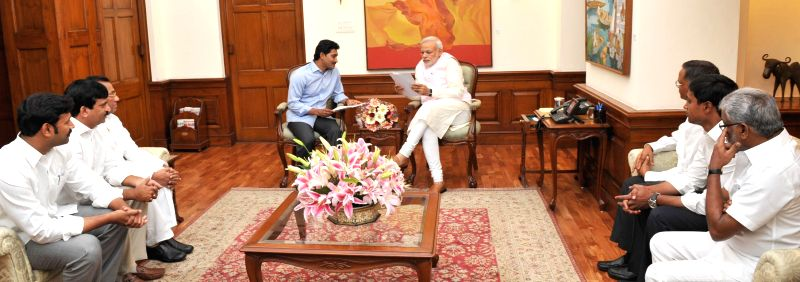 Y S R Congress chief YS Jaganmohan Reddy calls on Prime Minister Narendra Modi in New Delhi, on March 30, 2015. - Narendra Modi