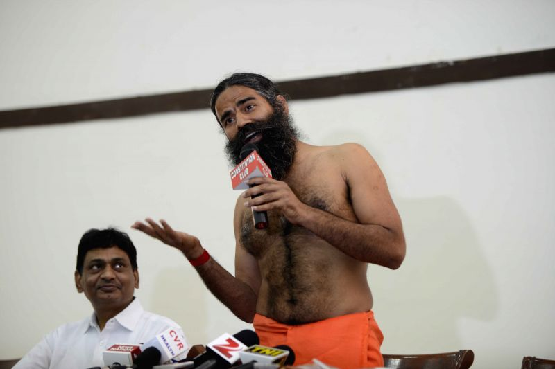 Yoga guru Baba Ramdev addresses during a press conference regarding `Divya Putrajeevak Seed` in New Delhi, on May 1, 2015.