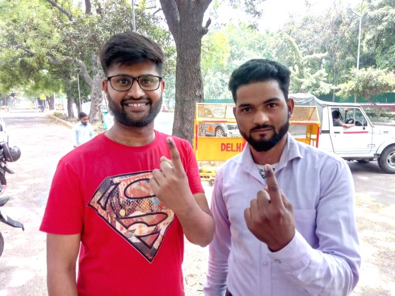 New Delhi: Young voters show their forefinger marked with indelible ink after casting vote during the sixth phase of 2019 Lok Sabha polls, in New Delhi, on May 12, 2019.