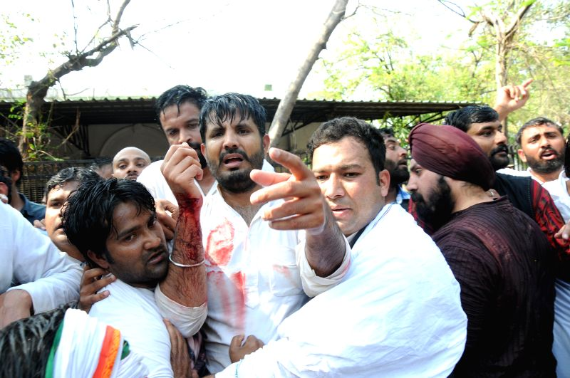 Youth Congress chief Amrinder Singh Raja Brar gets injured in a lathi charge during a Congress demonstration against land acquisition bill at Jantar Mantar in New Delhi, on March 16, 2015.