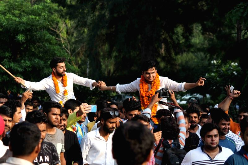 New DUSU president Rocky Tuseed celebrates with with fellow members celebrate after NSUI bagged the posts of President and Vice President in the DUSU elections in New Delhi on Sept 13, ...