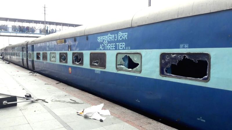 New Jalpaiguri: Window panes of train smashed by aspirants of Railway job at New Jalpaiguri Junction railway station on May 21, 2017. A section of aspirants became violent after their demand for a ...