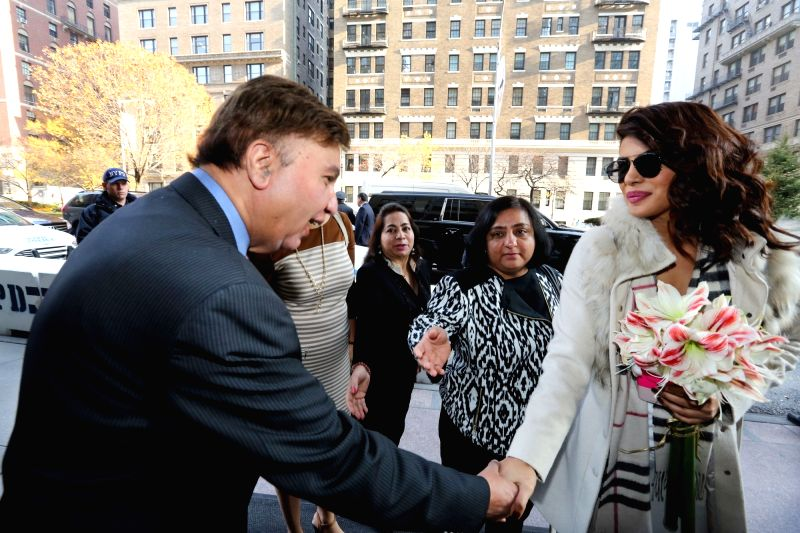 "New York : Actress Priyanka Chopra being welcomed by Eros International President Ken Naz as she arrives to address a press conference regarding her upcoming film ""Bajirao Mastani"" in New ..."