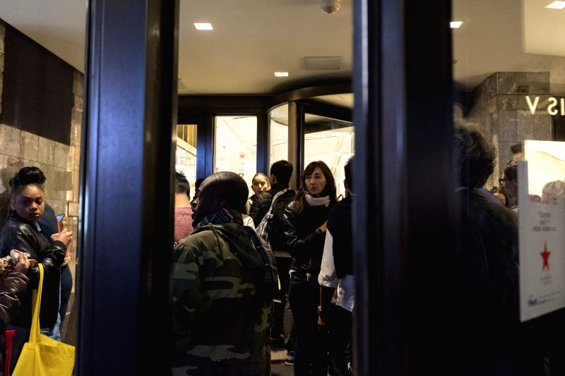 NEW YORK, April 15, 2017 - Shoppers wait outside the Macy's Herald Square after the store temporarily closed due to false alarms of shooting in Manhattan of New York City, the United States, April ...
