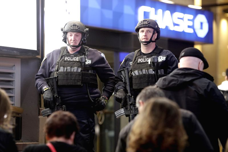 NEW YORK, April 15, 2017 - SWAT officers guard outside Penn Station in Manhattan of New York City, the United States, April 14, 2017. False alarms of shootings at Penn Station, Macy's Herald Square,  ...