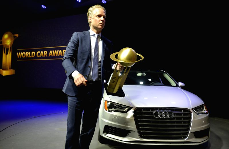 Scott Keogh, president of Audi of America, accepts the award for the 2014 World Car of the Year for Audi A3 at the 2014 World Car Awards (WCAs) prize-giving ...