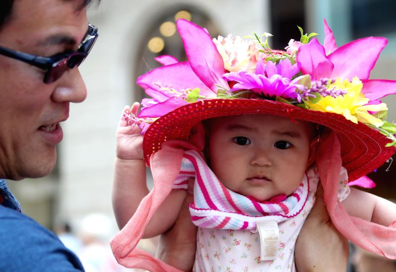 NEW YORK, April 17, 2017 - A baby with elaborately-decorated bonnet takes part in the Easter Bonnet Parade in New York, the United States, April 16, 2017. Each year on Easter, New Yorkers show off ...